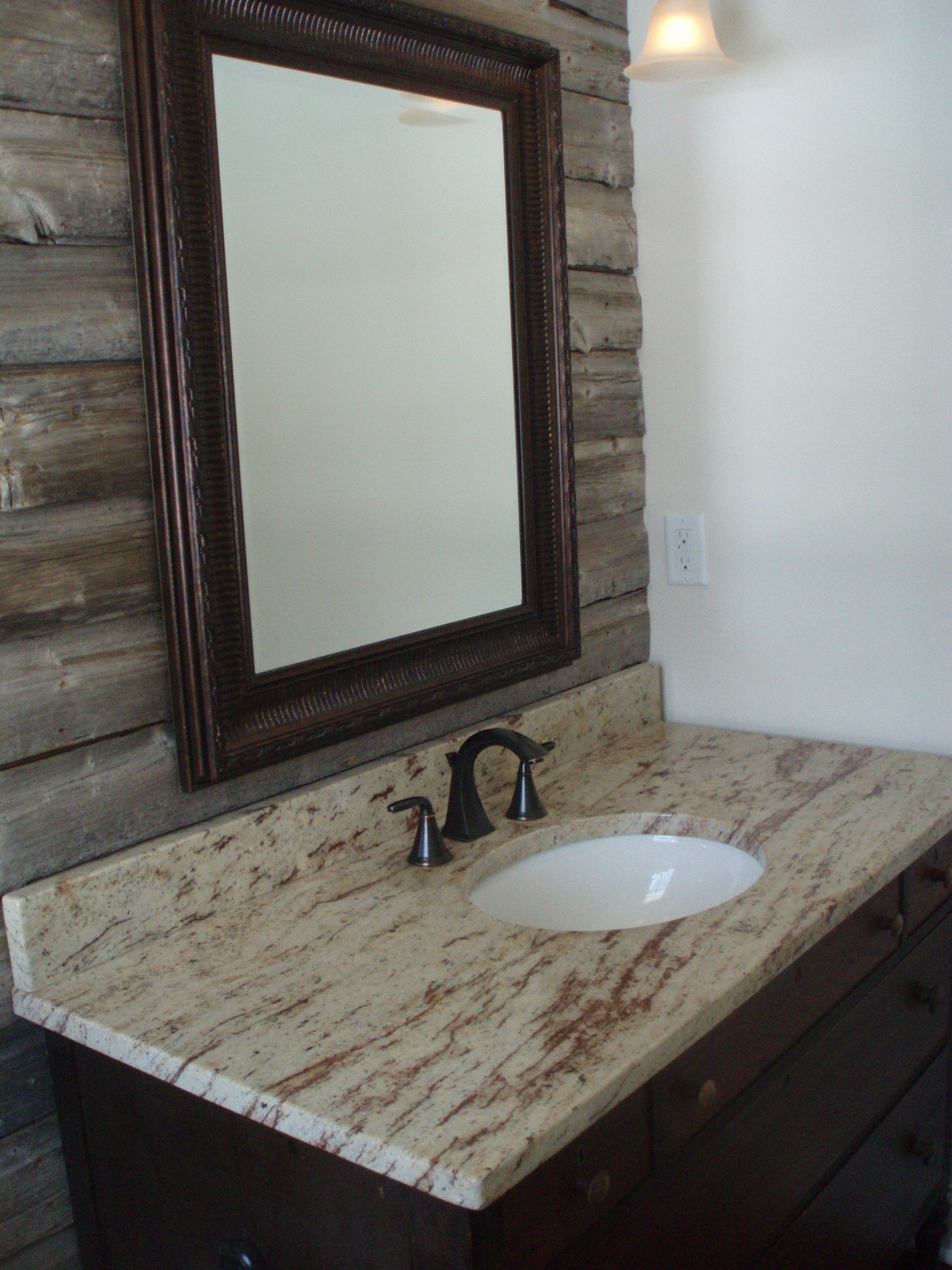 Powder room with barn wood accent wall granite counter for Bathroom accent ideas