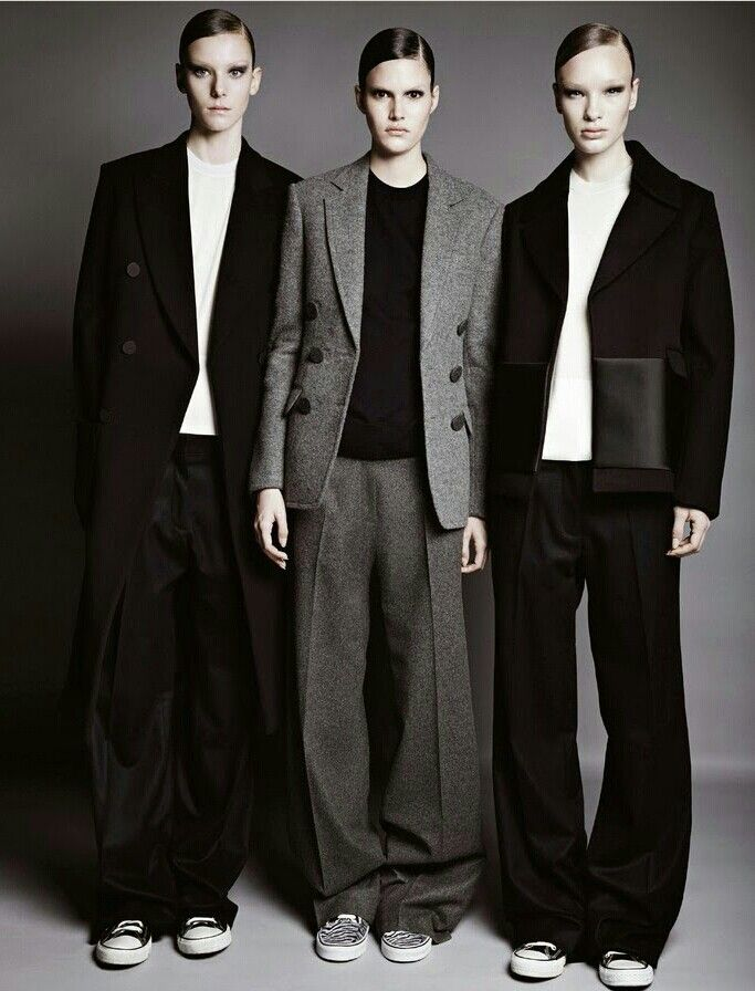 The looser fit and boxy shape of the outfits give a more masculine line to the body