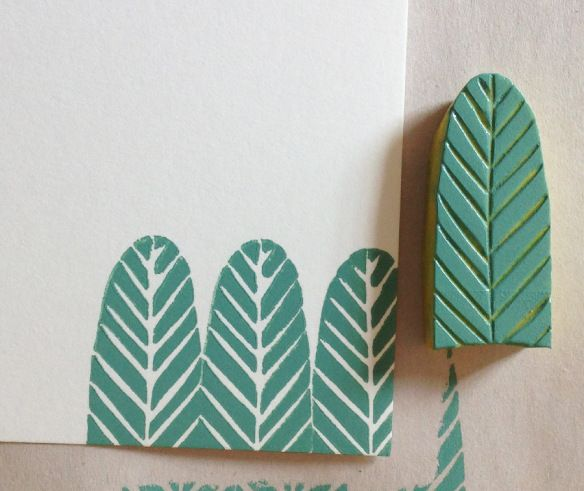 I carved this small stamp of a feather and made a couple of cards: