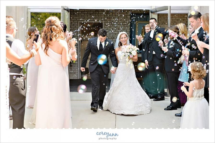 outdoor wedding ceremony sites in akron ohio%0A Josh and Cara u    s wedding ceremony exit with confetti cannons at the Church  of the Gesu in Cleveland by Corey Ann Photography