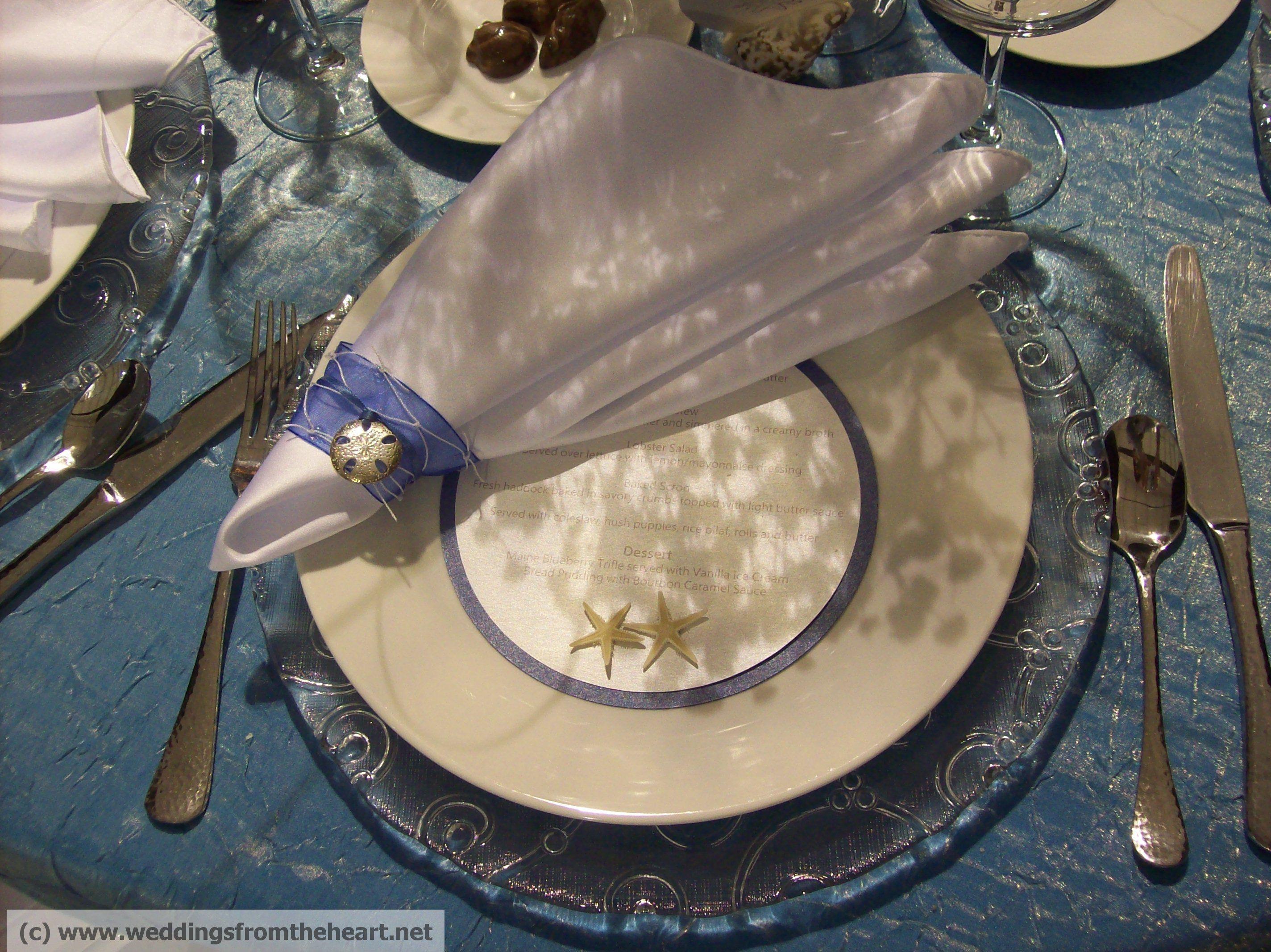 Starfish and seashell embellishments on the menu card and