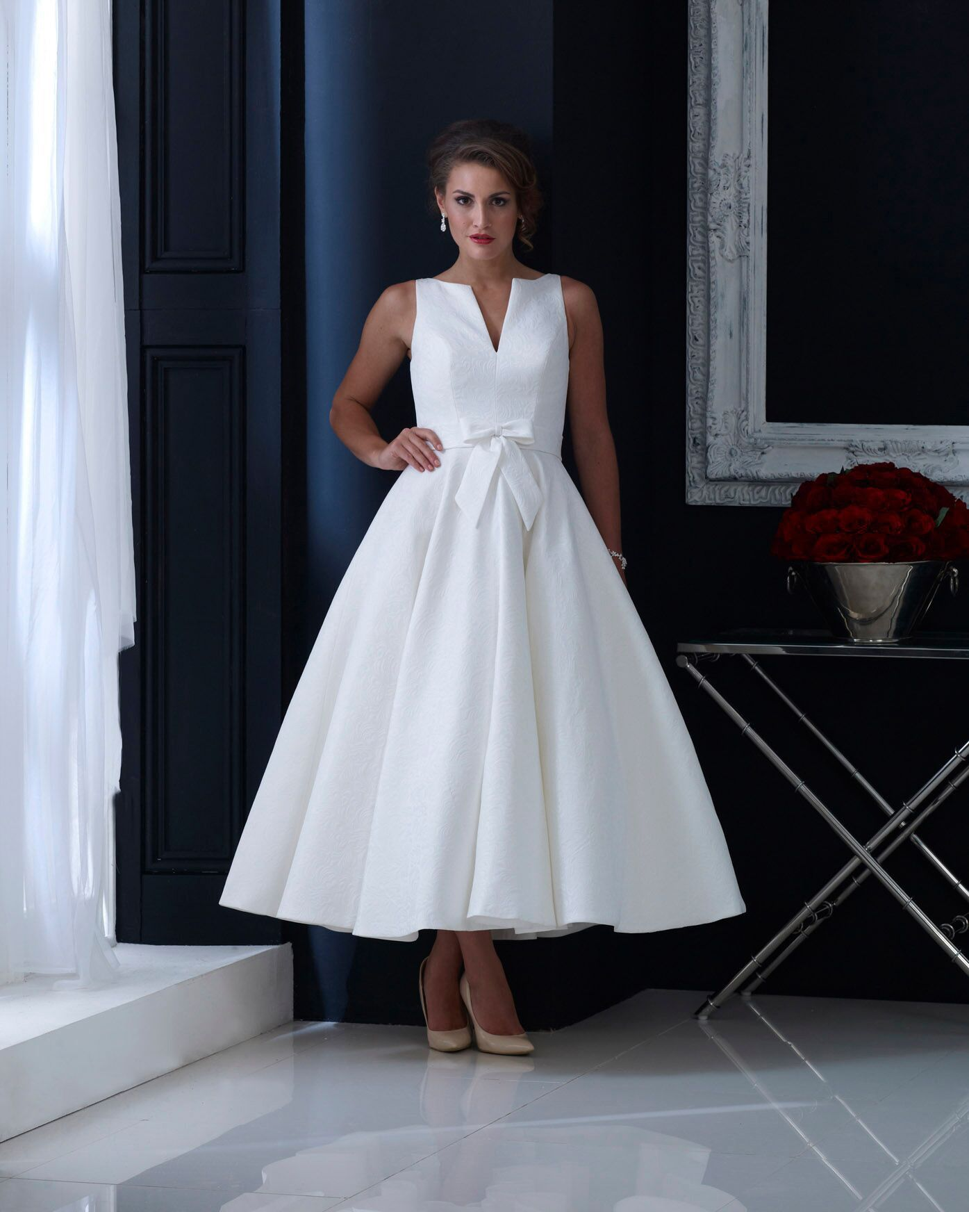 f250d885d4ec hn-veronica Brocade tea length wedding dress with subtle bow and elegant cut