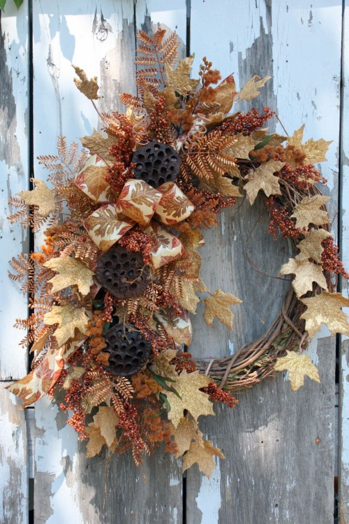 Fall Wreath, Gold Maple leaves, Lotus Pods, Berries, Leaf Ribbon via Etsy.