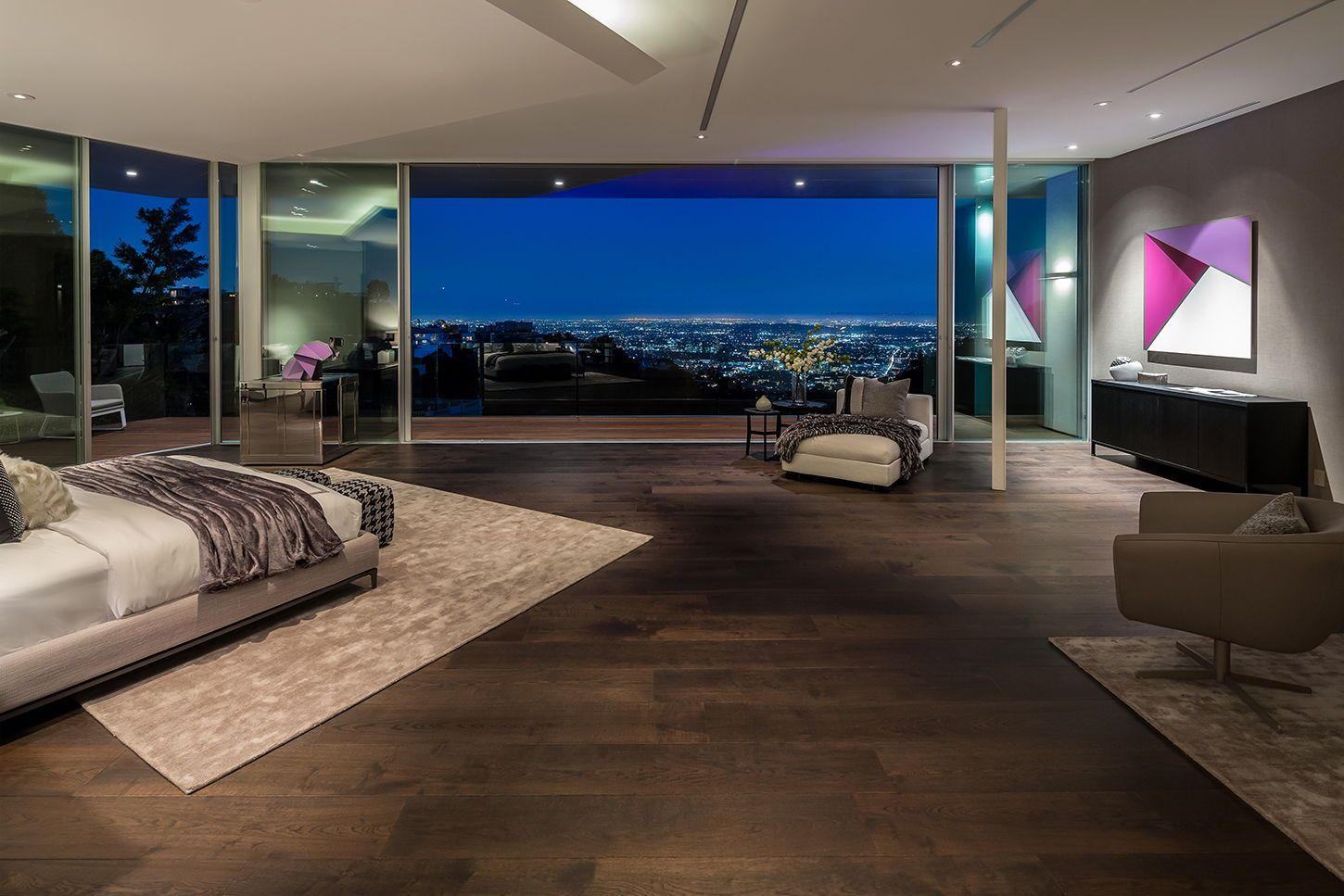 Nighttime View Of A Modern Master Bedroom With Custom Sliding