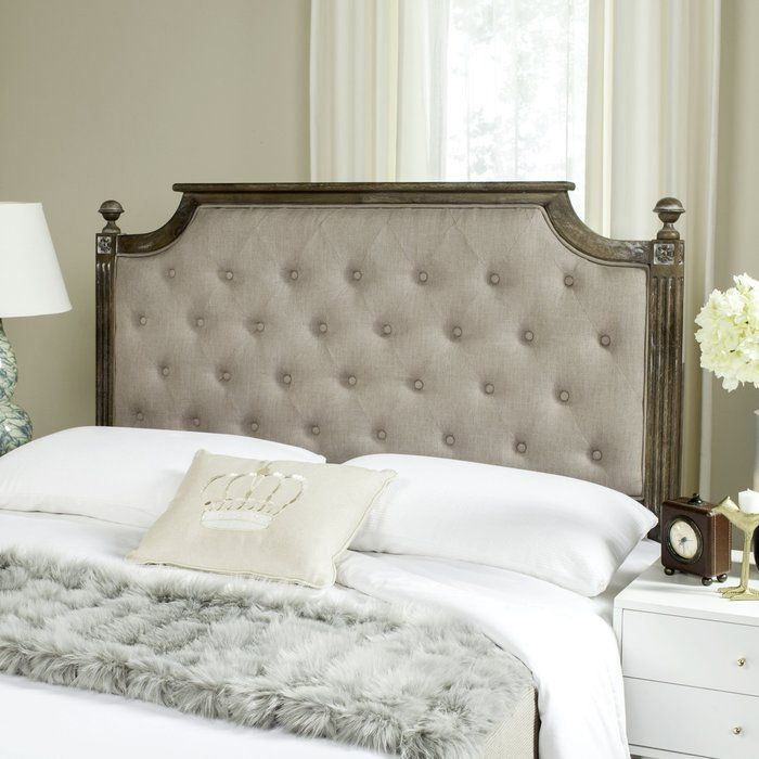 French country-flair abounds with this rubberwood linen-upholstered