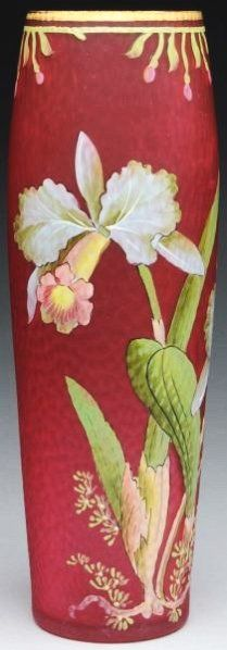 Attributed to Legras or Mont Joye, Iridescent Red French Art Glass Vase, with martele finish and hand painted enamel decoration of cattleya orchids. circa 190