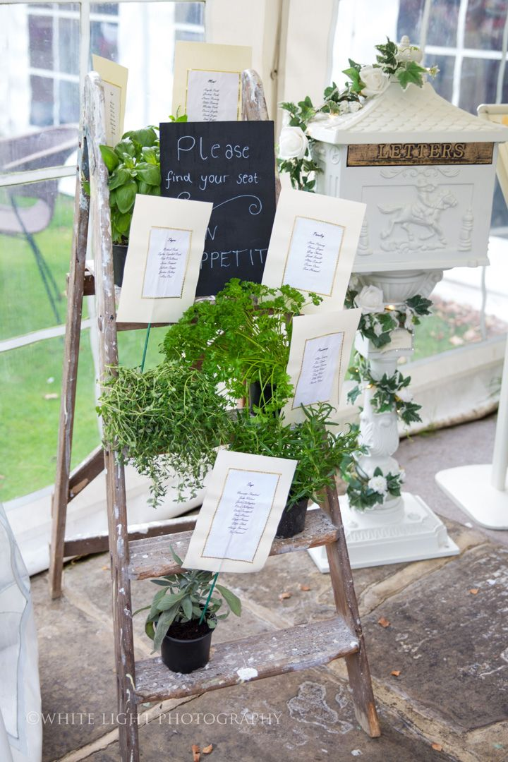 Herb pot as wedding seating chart on old step ladder