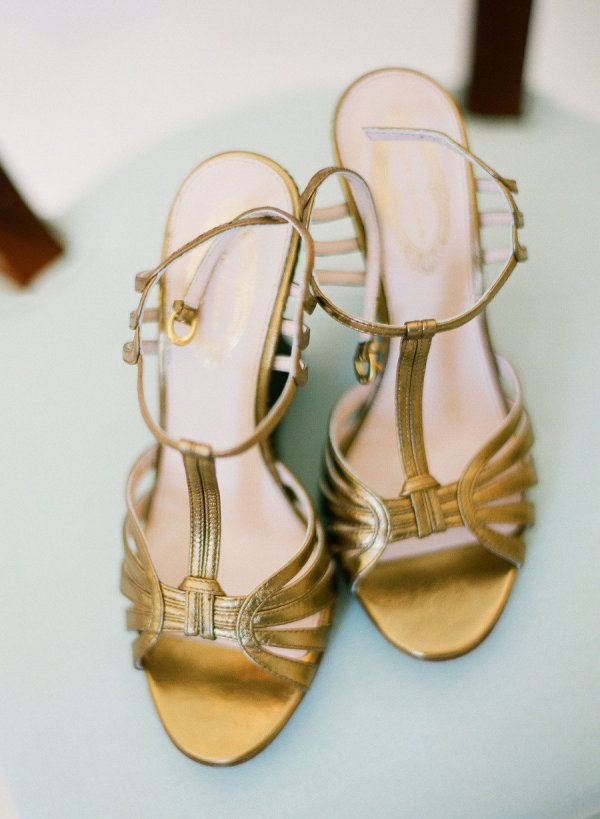 Strappy gold heels make us swoon. Photography by landonjacob.com
