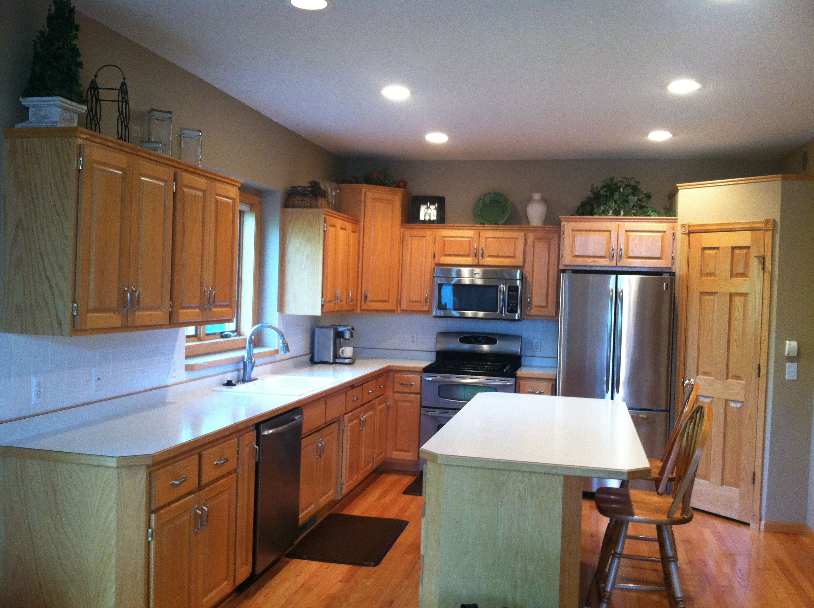 before photo oak cabinets with brushed