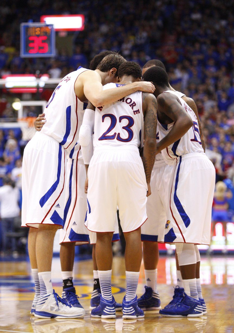 Kansas' starters huddle up in the second half on Saturday