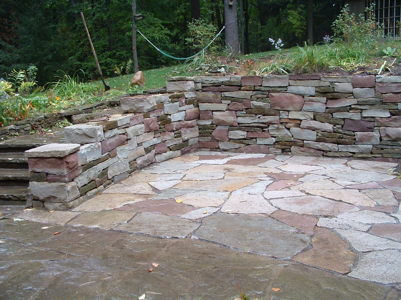 Patio Designs Among Retaining Walls Matched With Stone ...