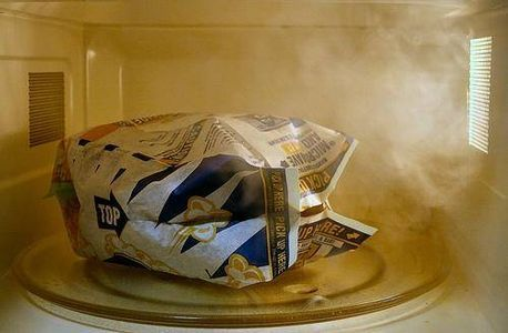 clean burn stains in a microwave oven
