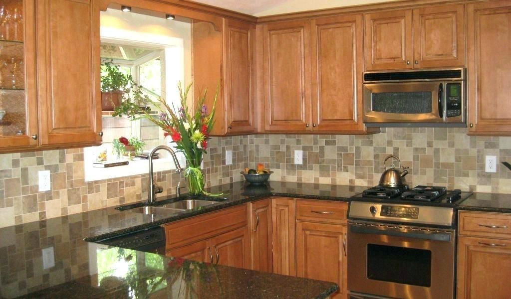 Quartz Countertops With Honey Oak Cabinets Kitchen Light # ... on Light Maple Cabinets With Black Countertops  id=38498