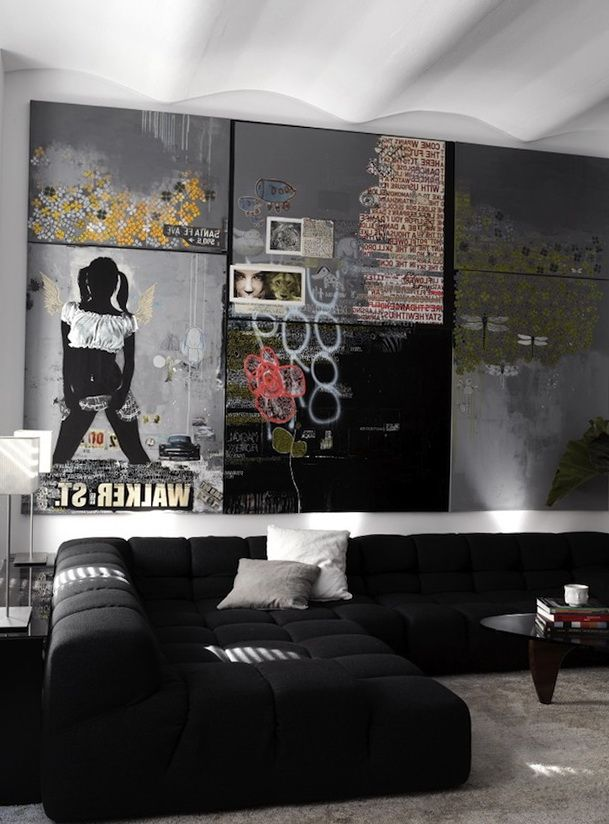 Black Couch With Full Wall Art