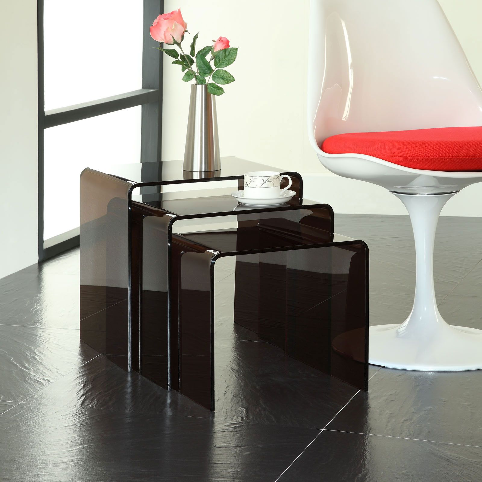 See more clearly with the Clear Nesting Tables. Made of rounded acrylic sheets, the three-piece set of tables keeps large and small spaces organized. Invite guests over, then nest the tables together and clear up the space.