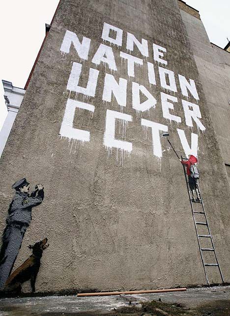 Banksy pulled off an audacious stunt to produce what is believed to be his biggest work yet in central London. The secretive graffiti artist managed to erect three storeys of scaffolding behind a security fence despite being watched by a CCTV camera. (Banksy, 2008)