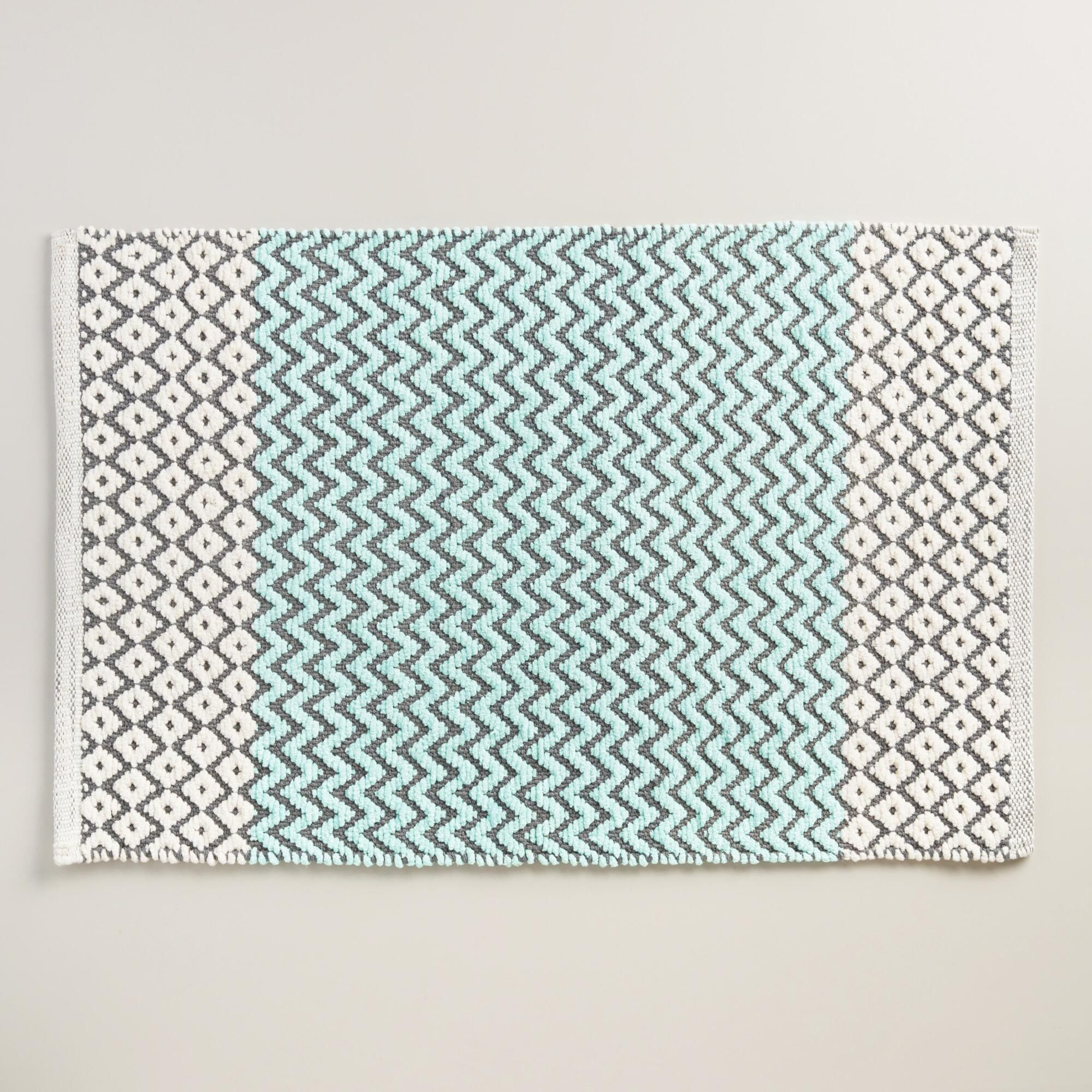 A woven diamond design in aqua, ivory and gray with plush cotton ...