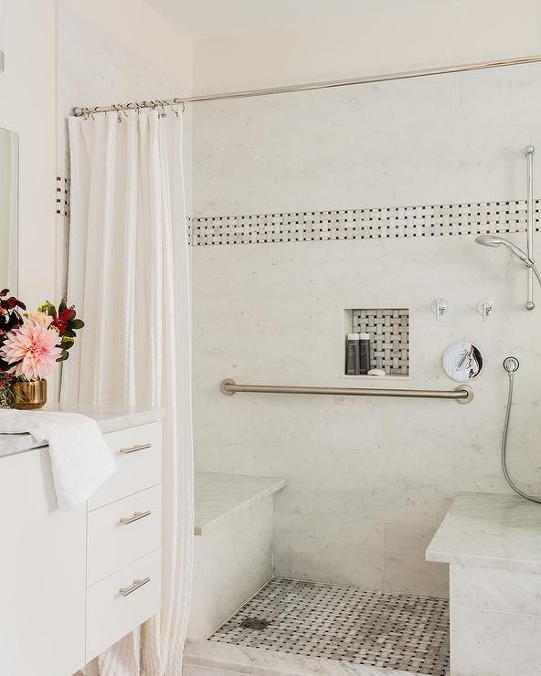 Behind A White Shower Curtain Hung From A Satin Nickel Rail This