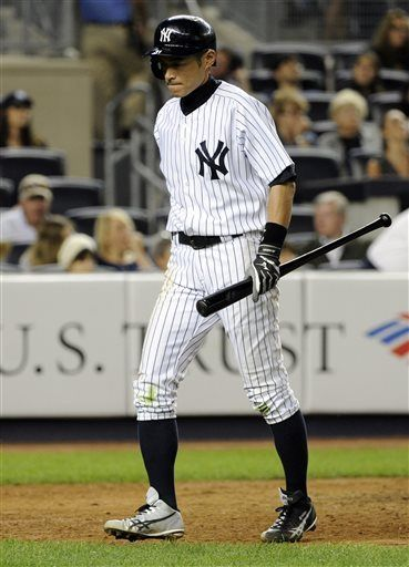 New York Yankees Ichiro Suzuki walks off after striking out to end the eighth inning of a baseball game against the Seattle Mariners, Thursday, May 16, 2013, at Yankee Stadium in New York.