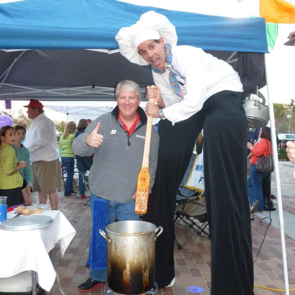 giant chef stilt walker at the uncle don u0027s chili cook off event in