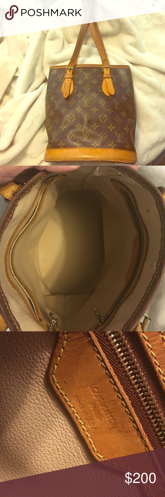 Louis Vuitton bucket bag Identification ID SD 1023 Louis Vuitton bag leather is naturally faded in areas from use. Wear on inside is pictured. No scratches or wear on logo leather. Beautiful bag, just upgrading. Louis Vuitton Bags