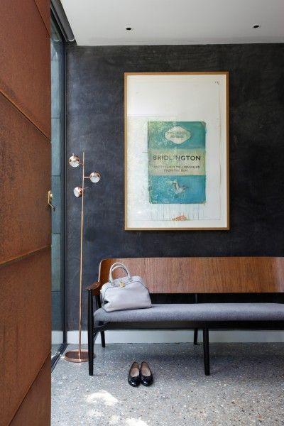 Metallic floor lamp, grey walls and walnut sofa   Intriguing ...