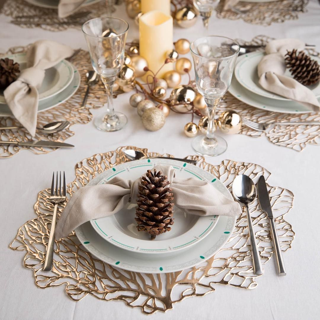 21 Christmas Tables That Prove There S More To Life Than Red Green And Gold Christmas Table Decorations Table Decorations Christmas Table Settings