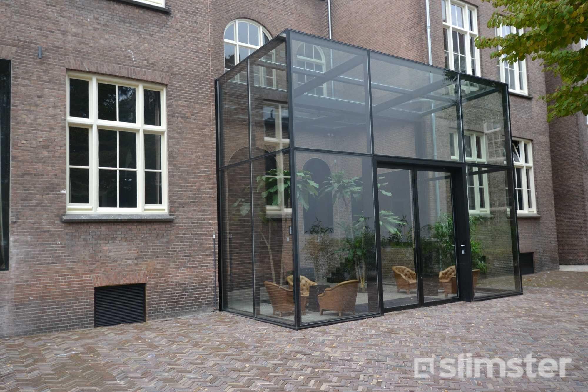 Stalen serre uitbouw prijs per m2 en info serreaanbouw for Glazen uitbouw