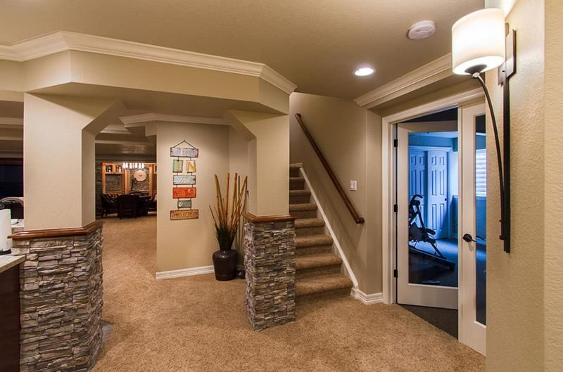 22 Lovely Setting In This Lovely Finished Basement Design Carpet Stone And Wood Accents Come Finished Basement Designs Basement Remodeling Basement Design