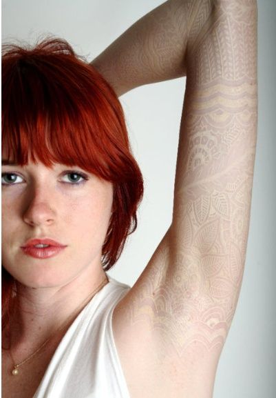 white lace tattoo, subtly beautiful. Too bad white tattoos don't work on dark skin.