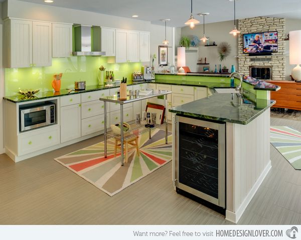 Image: Bay Cabinetry & Design Studio  The pop of colors everywhere from this kitchen sure is stunning! The back splash pretty much complements the beautiful area rug just beneath the industrial kitchen table.