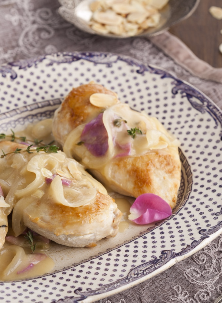 This elegant dish keeps its chicken moist by baking it in a rich wine sauce.