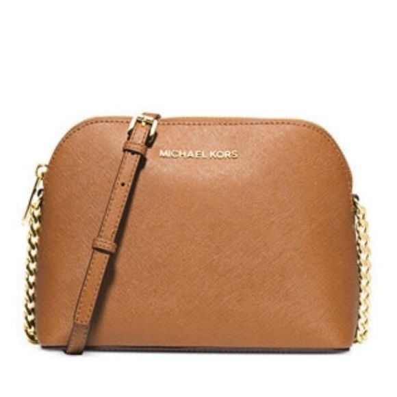 ✨TRADED✨ ✨looking to trade✨ my tan Cindy crossbody. Brand new never used. Wanting another Michael Kors crossbody bag in black. Will possibly sell; firm price. Michael Kors Bags Crossbody Bags