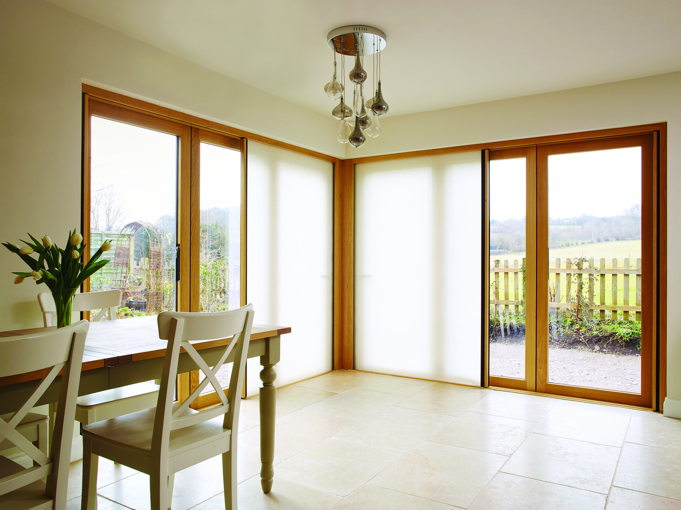 Centor Integrated Folding Doors with light-filtering shade installed in a home in the English & Centor Integrated Folding Doors with light-filtering shade installed ...