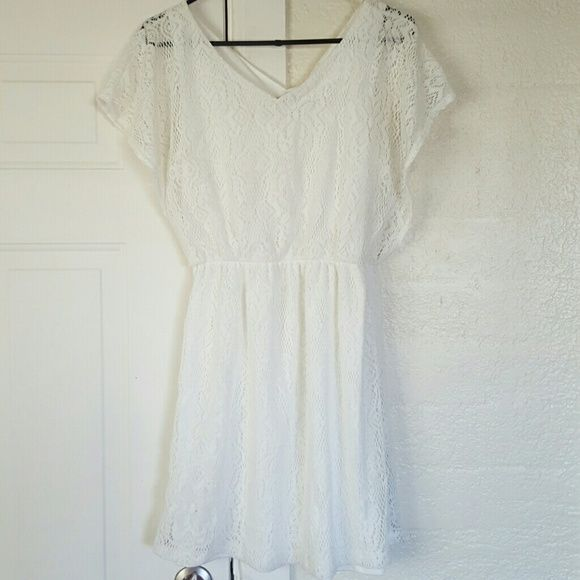 White Crochet Dress Really cute crochet dress with lining on bodice.  The sleeves are not lined.  The dress comes down above my knee and I am 5'6.  Worn once and has a little stain in the lining.  You cannot see it on the outside.  It has an elasticized waist and the fabric is a little stretchy although it is 100% polyester. Bailey Blue Dresses Mini