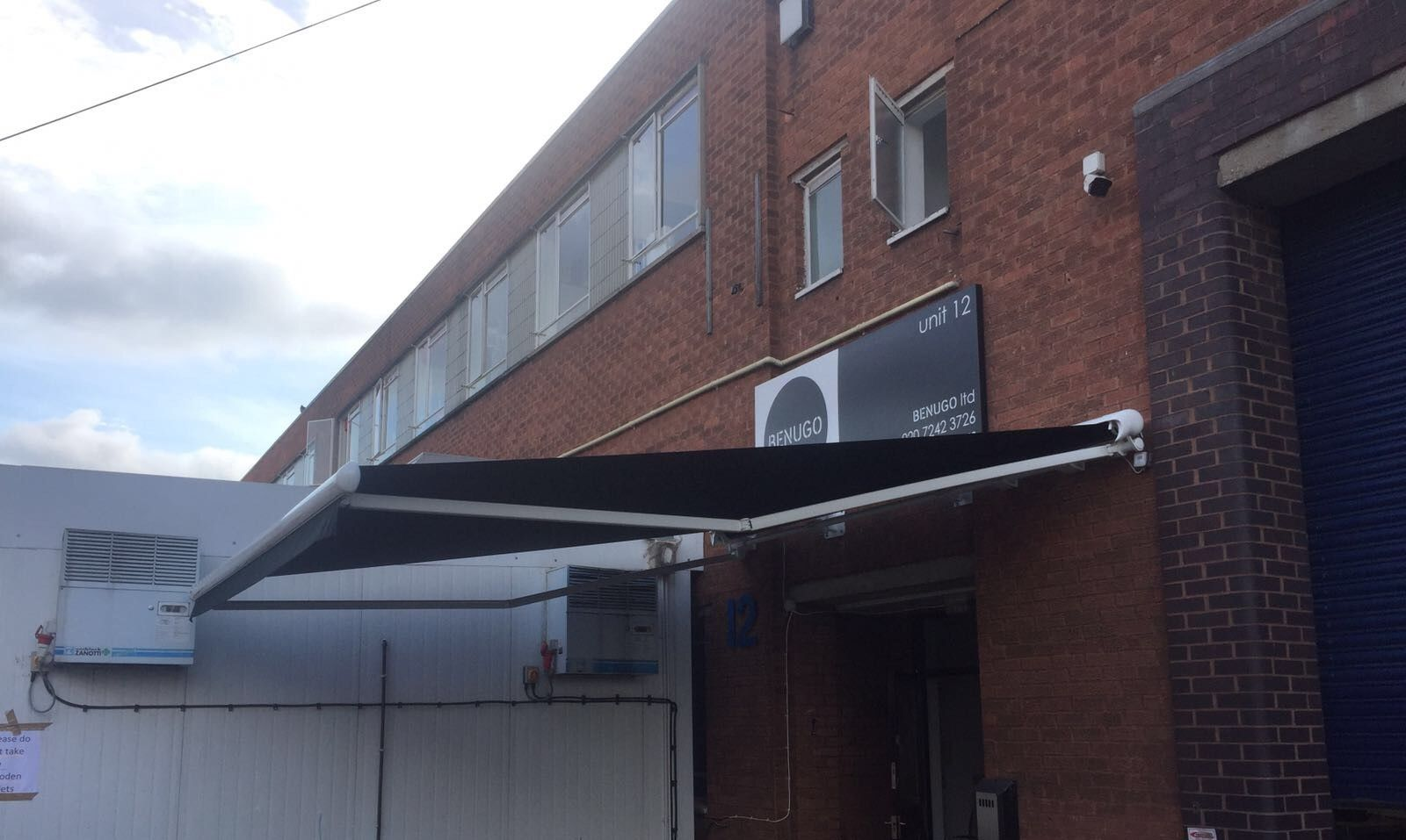 Here Is An Awning Specially Designed To Give A Larger Projection Then The Actual Width This Is The Markilux Uk Stretc Shop Awning Blinds Wall Spaces
