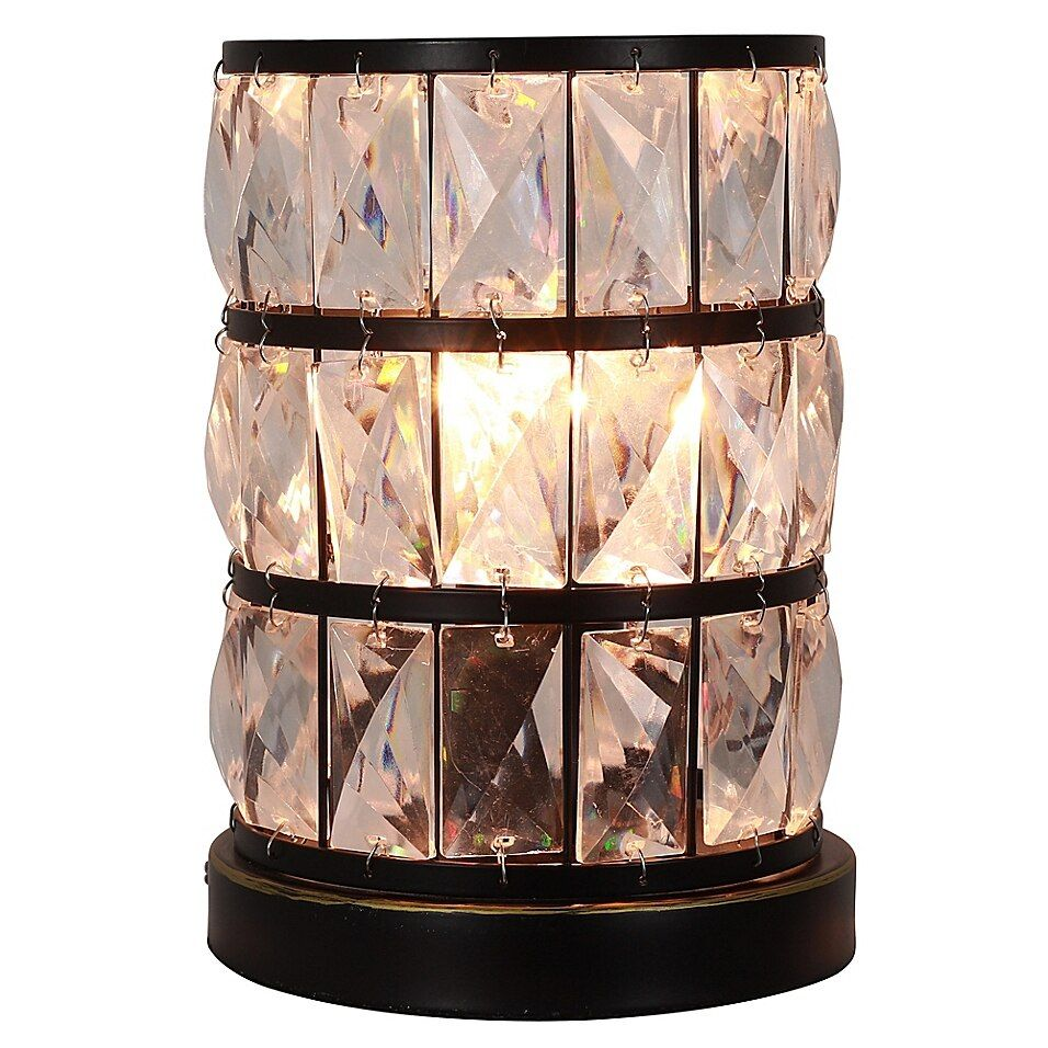 Décor Therapy Hayes Touch Control Uplight In Bronze - Illuminate your space in style with the Décor Therapy Hayes Touch Control Uplight. This stunning light boasts a round silhouette and a faceted clear acrylics for an eye-catching finish. Simply touch the lamp to turn it on.