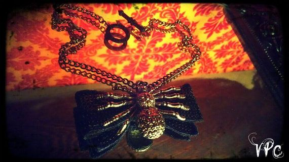 Cute & Creepy Spider Bow Necklace by VoNPuRRCreaTionS on Etsy, $17.00