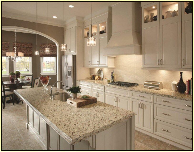 Crema Perla Granite With Cream Cabinets And Backsplash Kitchen