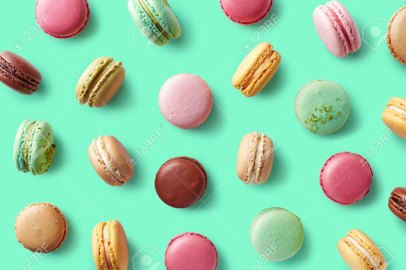 Pattern of colorful french macaroons on blue Stock Photo