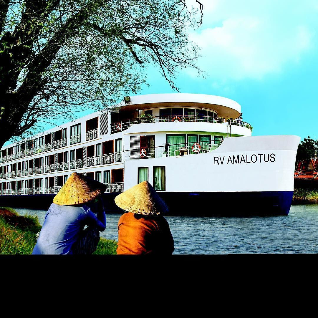 The APT ship Amalotus cruising down the river in Cambodia. Image courtesy of APT.