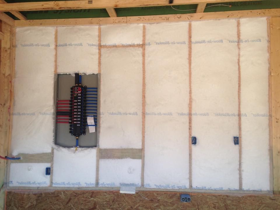 Close up of how the blowninsulation packs the walls in a