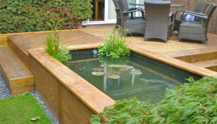 Raised ponds google search garden pinterest raised for Raised koi pond ideas