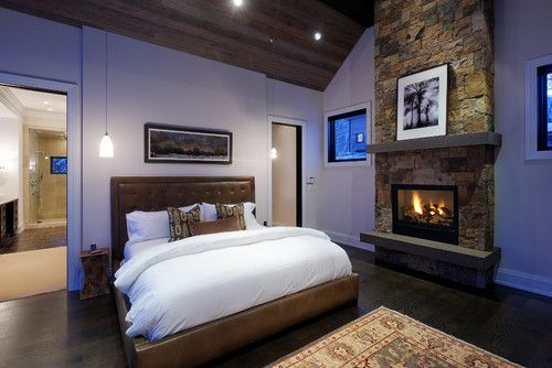 Contemporary Master Bedroom with Beautiful fireplace and luxurious