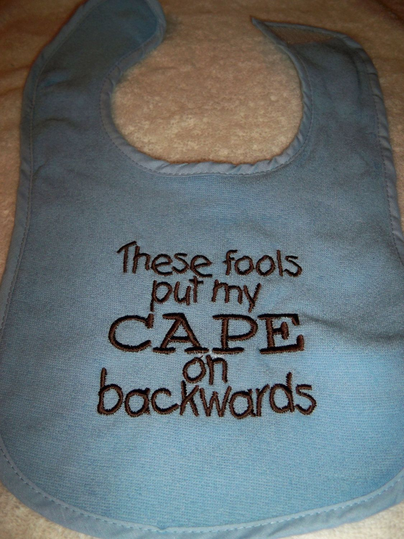 Blue Bib - These Fools Put My Cape on Backwards - Baby Girl or Boy Bib - Blue Bib with Brown Embroidery. $6.50, via Etsy.