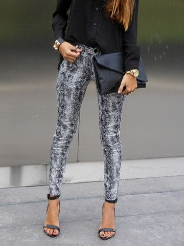 Printed pants, strappy sandals, envelope clutch & a loose blouse topped off with gold accessories - evening city chic.