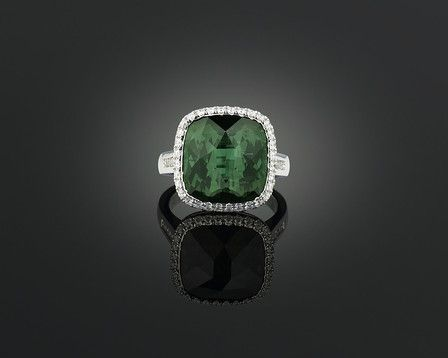 A captivating green tourmaline glows in this elegant ring.  ~ M.S. Rau Antiques