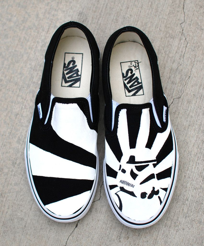 a49fb4c06ba3f These one-of-a-kind hand-painted Vans Slip ons Feature a black and ...