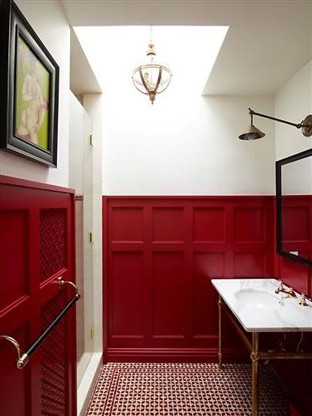 Designer Sara Story's NY bathroom w/ exciting red wainscoting & red & white tiles | housetohome