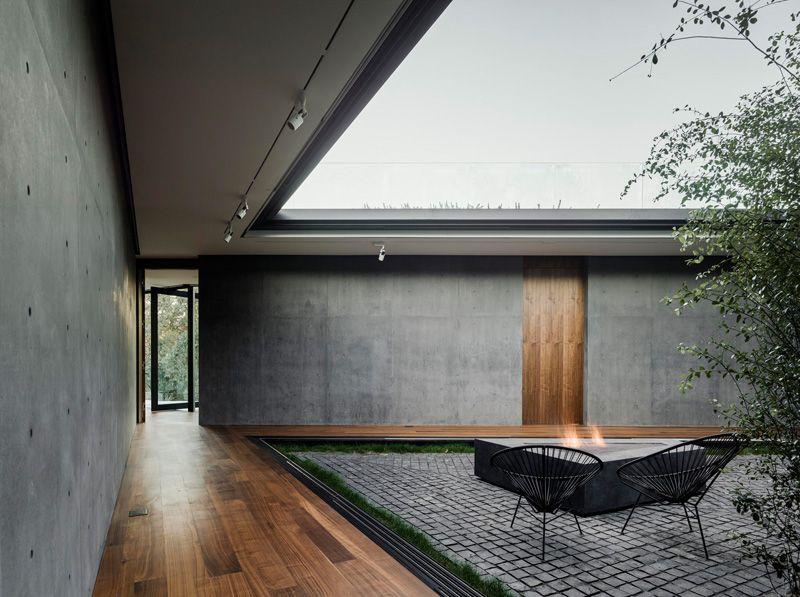 Cast In Place Concrete Walls + Wooden Doors + Large Sliding Door Panels +  Cobble Stone